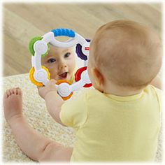 It's a tambourine that's just the right size for little hands to bat, grasp and tap. Bright colors, clacker sounds and a large, shiny mirror help to strengthen baby's senses as she rocks out. Roly-poly rocking action adds to the fun!