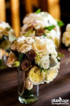 Lee's Bridal with Patience garden roses, hypnose roses, lisianthus, ranunculus and dusty miller by Plum Sage Flowers