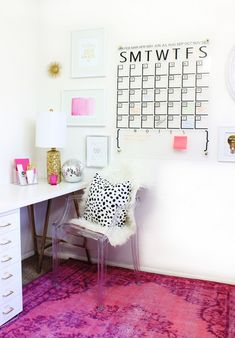 Love this DIY Acrylic Calendar and this craft room is so cute! Love the pink and gold accent!
