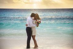 A stolen kiss during a romantic wedding on Petite Anse beach at Four Seasons Resort Seychelles #luxbride #realweddings