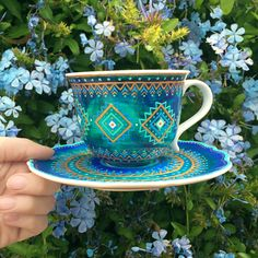 Hand painted teacup, inspired by tropical ocean reefs and henna design.
