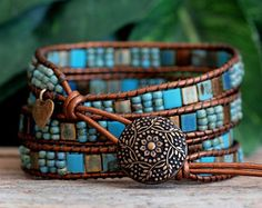 NEW IN THE SHOP! This beaded leather wrap features four bracelets in one! Just wrap it four times on your wrist, fasten the button closure and you have four distinct yet coordinated bracelets, for that layered-boho look. It features a gorgeous assortment of top quality beads, including 5x5mm Miyuki Tila Beads and Seed Beads, Matubo Super Duo Beads, Czech Mates Tile Beads and Czech Glass and Crystal Beads, in gorgeous shades of bronze and turquoise, all meticulously ladder-stitched on to top…