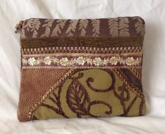 Fancy zipper clutch bag with bead pulls, upcycled from upholstery and fancy trims by TheNomadsNeedle on Etsy