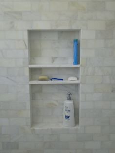shower niche with enough height for costcosized shampoo on bottom shelf regular sized