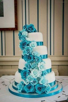 Turquoise Rose Cascade Wedding Cake A Or Delicate Roses In Various Shades Flow Down Four Tier