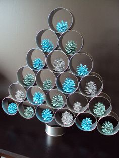 Tuna can Christmas tree.  You can hang ornaments with bobby pins or set them in like these spray painted pine cones.