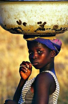 Africa | Portrait of a girl carrying a big bowl on her head, Benin | © Sergio Pessolano
