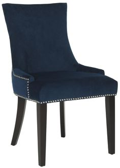 W/ birch legs & nailhead trim, Safavieh's MCR4709L-SET2 are navy cushioned dining chairs in a slight hourglass shape for an elegant, functional furnishing.