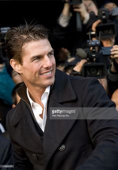 Actor Tom Cruise poses for photographers upon his arrival at Gimpo Airport on January 16, 2009 in Seoul, South Korea. Tom Cruise is visiting South Korea to promote his recent film 'Valkyrie.'