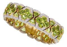 Estate Jewelry:Bracelets, Peridot, Diamond, Gold Bracelet The bracelet f...