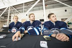 Winnipeg Jets prospects (L-R) Nikolaj Ehlers, Joshua Morrissey and Nic Petan take a break from opening hockey cards at the 2015 NHLPA Rookie Showcase at Mattamy Athletic Centre on September 2015 in Toronto , Ontario , Canada . Jets Hockey, Hockey Baby, Athletic Center, September 1, Hockey Cards, Hockey Players, Nhl, Ontario, Toronto