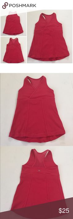 Lululemon Deep V Faux Wrap Tank, size 6 Lululemon Deep V Faux Wrap Tank in size 6. Size is confirmed by size dot in removable pad area. Does not come with the pads. Color is a Berry Pink color with lighter pink stitching. Features a racerback back area with mesh. Flat lay measure from top of strap to hem is approximately 21.5 in front, and approximately 22.5 in back. In overall good condition, please look at all photos and ask if you have any questions. lululemon athletica Tops Tank Tops