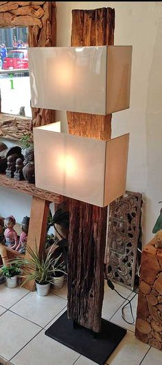 A floor lamp hand crafted in Indonesia from a reclaimed old growth teak railroad tie. From Impact Imports in Boise and Philadelphia.