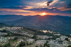 Sunset over rice terraces - May is planting season in Yuanyang, China, our photo tour group was there, and I shot this beautiful sunset over rice terraces.
