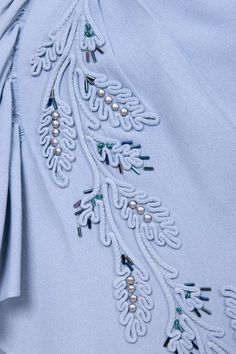 Embellished blue dress, detail.  No one wants to take the time to do this kind of intricate embellishment any longer.  It's becoming a lost art.