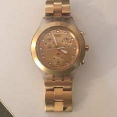 Gold swatch watch Gold swatch watch, unisex Swiss chronograph full blooded gold tone aluminum bracelet, water resistant to 30 meters chronograph dial with crystal markers.. Perfect condition. Swatch Accessories Watches