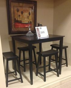 The Conrad counter height table casual dining and backless bar stools in a hand rubbed dark black finish offer a sophisticated look to your home perfect for entertaining and every day use. The straight lines of the tapered legs accent to sleek contemporary design ideal for any decor. The comfortable and inviting style adds function to your kitchen, great room, and more. At #AshleyFurniture in Richland, WA #Contemporary #Dining #TriCities #Wa #TriCitiesWA #Yakima #WallaWalla