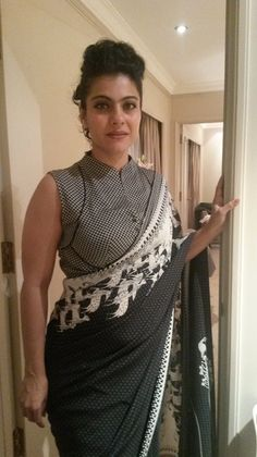 Check out Kajol wearing an AM:PM (Ankur Modi & Priyanka Modi) black and white sari for an event in the Mumbai. She was styled by Triporna Majumdar. Blouse Designs High Neck, Fancy Blouse Designs, Sari Bluse, Stylish Blouse Design, Designer Blouse Patterns, Designer Dresses, Anarkali, Lehenga, Blouse Models