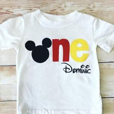 """This set of 2 Mickey Mouse themed tees will be the perfect outfit choice for photos and birthday parties!The birthday tee design is a ONE, with the """"O"""" being Mickey's profile.  Each letter is hand cut fabric, that is fused to the shirt and then machine stitched with coordinating thread.  This is NOT a vinyl design.The sibling tee is designed the same.  The BIG is embroidered and the BRO is hand cut fabric letters sewn to the shirt.These shirts are all made to last, wash after wash.An added… Mickey Mouse Birthday Shirt, Mickey Mouse First Birthday, Mickey Mouse Outfit, 1st Birthday Shirts, Mickey Mouse Shirts, Boy First Birthday, Mickey Party, Birthday Games, Birthday Ideas"""