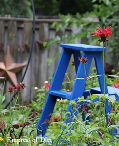 Old wooden ladders make wonderful garden art but the wood can rot when exposed to damp, wet weather. The solution? Exterior paint and rain boots!