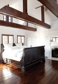 Contemporary Colonial Bedroom  Minimal furniture and a strict palette of white accents and dark wood offer a new take on a European country look.