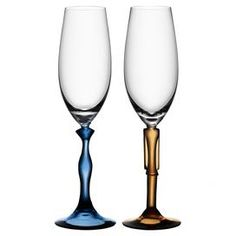 Two mouth-blown flute glasses with stems in the shape of a man and a woman.     Product: 2 Piece flute set    Construction Material: Glass    Color: Clear, orange and blue    Features:     Designed by Kjell Engman Mouth-blown  Lead free    Dimensions: 11 H x 2.125 Diameter each