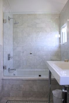 bathroom with tub shower combo featuring a Carrera Marble tub and showe. Stunning bathroom with tub shower combo featuring a Carrera Marble tub and showe.,Stunning bathroom with tub shower combo featuring a Carre. Bathtub Shower Combo, Bathroom Tub Shower, Guest Bathrooms, Small Bathroom, Bath Tub, Bathroom Ideas, Master Bathroom, Shower Ideas, Bathroom Black
