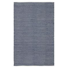 Add a refined touch to your master bath or kitchen with this understated hand-woven rug, featuring a diamond motif in navy.   Product: