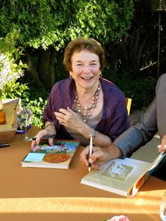 Frances and Ed signing books before the dinner kicked off