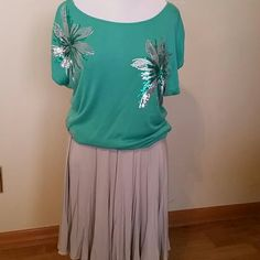 Skirt and sweater set Beautiful Aqua sweater with big sequined flowers. Soft silver-gray skirt with elastic waist.  Sweater is xl, skirt is L. I-N-C International Concepts  Sweaters Crew & Scoop Necks