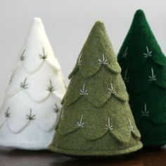 "Trees Set of Three - $40  this listing is for a set of three trees: off white, moss green and forest green.  trees are carefully handmade from felt, because these are individually handmade, yours may vary slightly from the picture.  size: measures about 3"" tall"