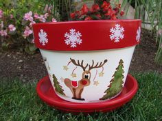 Hand painted 8 inch flower pot Painted saucer included Pot is painted in reds and whites with Reindeers and Christmas Trees all the way around the flower pot White Snowfl. Christmas Clay, Christmas Projects, Christmas Holidays, Christmas Decorations, Christmas Ornaments, Christmas Trees, Christmas Design, Flower Pot Art, Clay Flower Pots