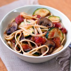 Fresh garden vegetables and pasta tossed with a chunky tomato sauce create a zesty Tuscan pasta.