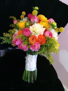I like this one but I don't like how the stuff sticks out.  Bright and fun bridal bouquet including crespedia (billy balls), dahlias, ranunculus and solidaster.