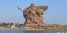 Damn. That's a good statue. This 158-foot-tall bronze figure depicts Guan Yu, an ancient Chinese general, and majestically towers over Jingzhou, China. Shanghaiist says that over 4,000 strips of bronze have been stuck onto the body of Guan Yu and he stands atop the 86,000 square foot Guan Yu museum. All that is great but damn, I just can't get over how fantastic the statue looks.