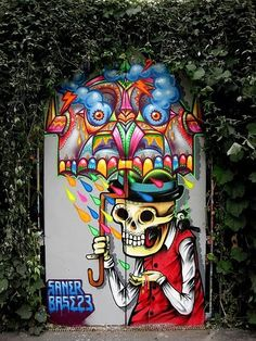 Street art. Saner. Colorful skeleton with umbrella.