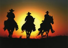 Cowboy Silhouettes with Sunset