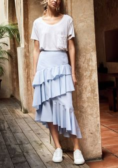 Turn up the volume with this asymmetrically drapped ruffle midi skirt. Versatile enough to dress up or down.