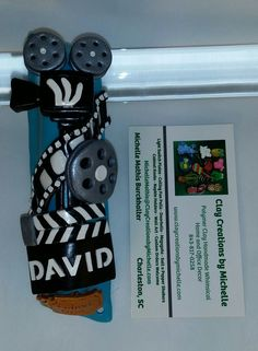 Movie Film Mezuzah - these with names on them are custom orders for a wonderful repeat customer....gifts for family and for sponsored kids. Made by Michelle Mathis Burckhalter using polymer clay - NO PAINTS!  Order info: michellemathis@claycreationsbymichelle.com