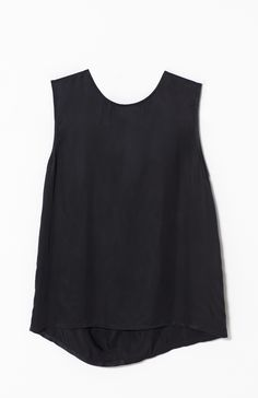 The Fold Back Sleeveless Top offers a floaty silhouette from a pleat pinched at the nape of the neck. This sleeveless top has a scoop neckline and a slight cascading hem. From the French Riviera to your wardrobe, wear this breezy number with cropped culottes or for a smart look, with slimline pants.