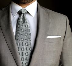 Simple white pocket square with subtle polka dots!