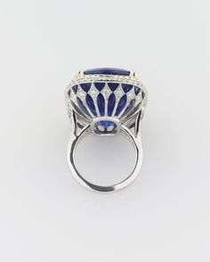 An incredible 45.26-carat cushion-cut tanzanite absolutely shines in this stunning ring ~ M.S. Rau Antiques