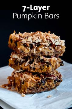 Easy to make and gluten-free, these Pumpkin 7-Layer Bars are a delicious and simple fall dessert that will have your taste buds spinning! Pecans, shredded coconut, butterscotch chips, chocolate chips, nutmeg, and pumpkin puree meld together to make these tasty sweet treats.