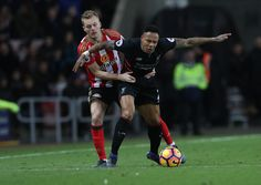 Sebastian Larsson of Sunderland vies with Nathaniel Clyne of Liverpool during the Premier League match between Sunderland and Liverpool at Stadium of Light on January 2, 2017 in Sunderland, England.