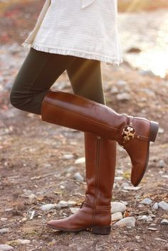 6af2d268ab Love this style ♥ Tory Burch brown leather riding boots with black jeans  and white knit
