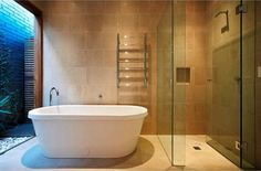 For the tile color, the shower shape, maybe a warning about the greenish cast of the glass. Nice tub!