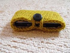 Simple crocheted phone case with button closure.