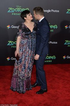 Loved up: She looked besotted with husband Josh Dallas - also 37 - at the El Capitan Theater