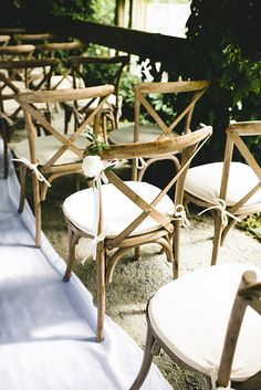 Single white blooms make the most stunning understated chair decor.
