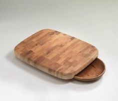 Edward Wohl End Grain Chopping Block with Cherry Bowl . $235.00. In the tradition of the beautiful and functional end grain chopping blocks, we offer our countertop version of these hard maple boards. Our chopping blocks are made for heavy use. They are an inch and a half thick hard maple on feet that keep them three quarters of an inch off the countertop. The two larger styles are available with a turned cherry bowl that slides partially underneath the choppi...